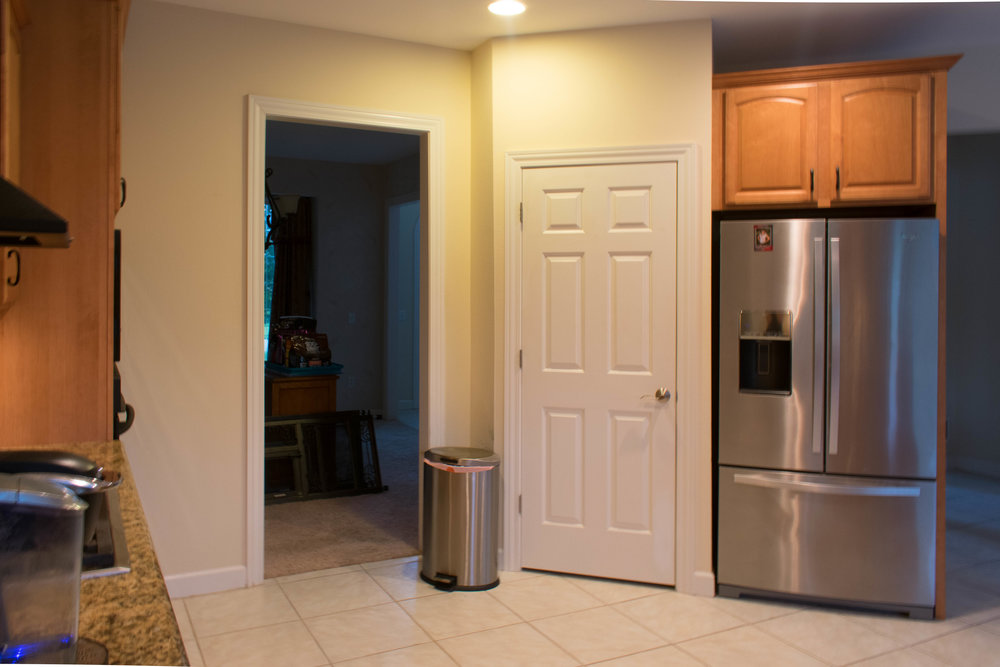 BEFORE-Dining room is closed off from the kitchen by a wall