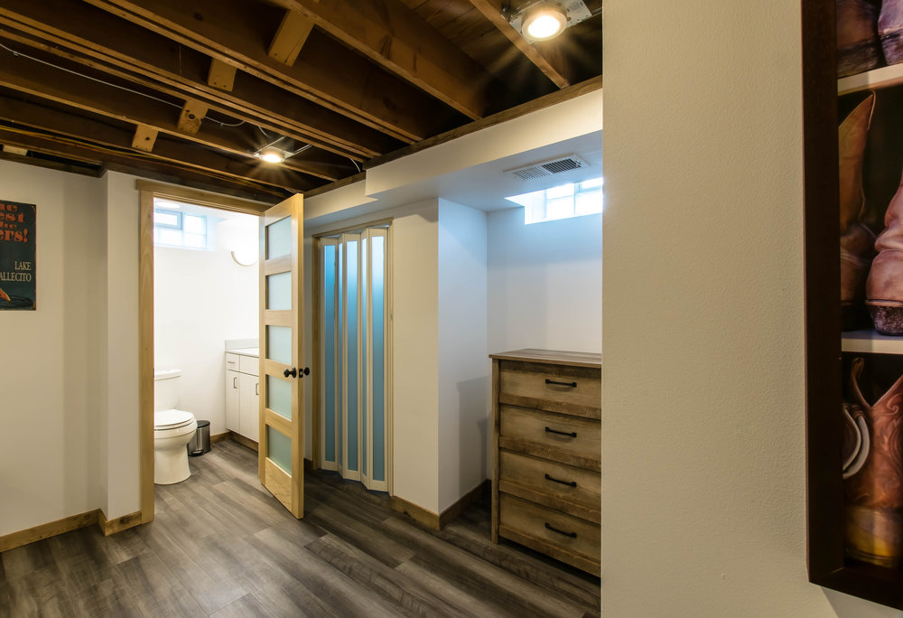 AFTER-new flooring, drywall, and a steam shower complete this space