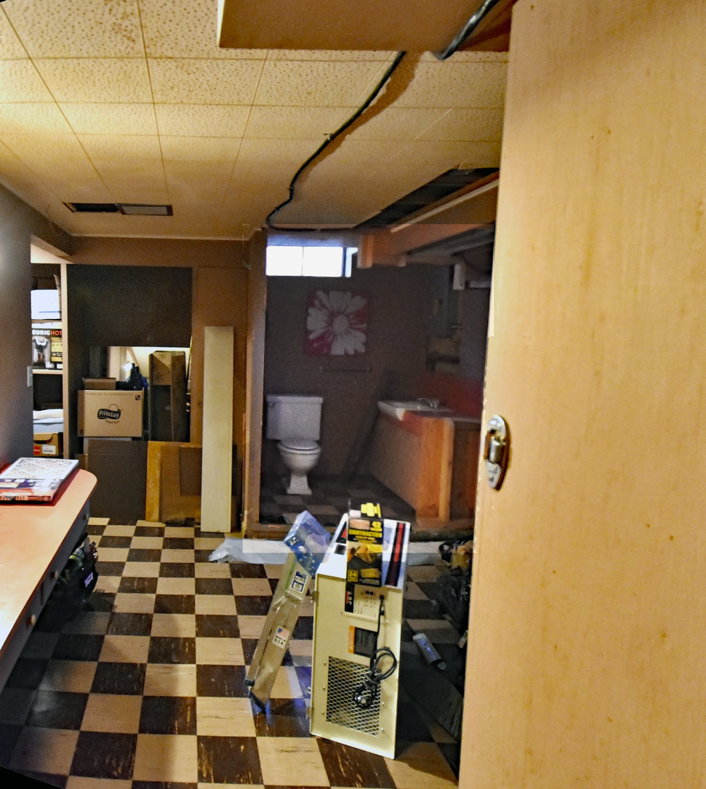 BEFORE-A dark and unfinished living space is in desperate need of a transformation