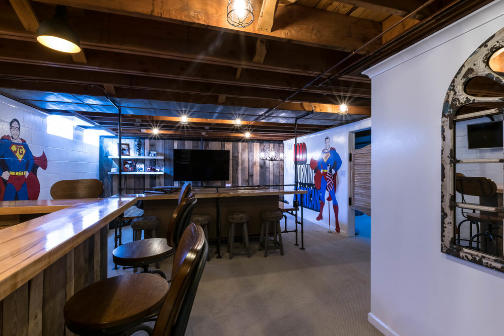 AFTER-Murals, saloon doors, live-edge bar sitting, and custom lighting transform the space