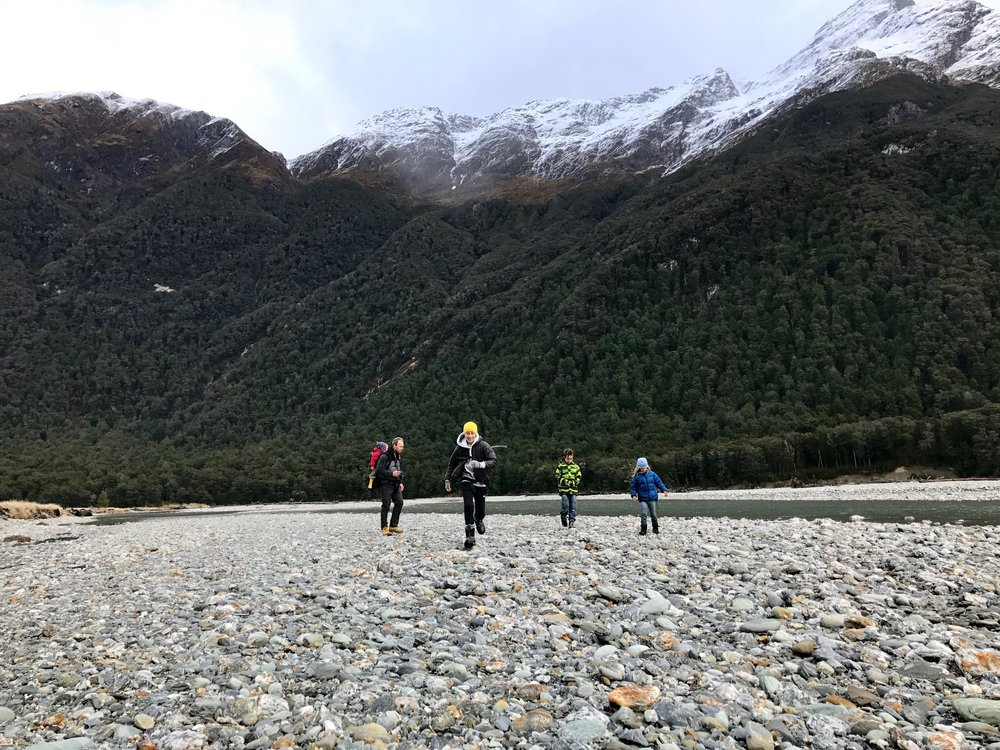 Exploring the South Island with our family. After days of skiing, we were taking a break from skiing and hiking through the Rees Valley . Rees River flowing by in the background. Photo taken by Lyzadie.