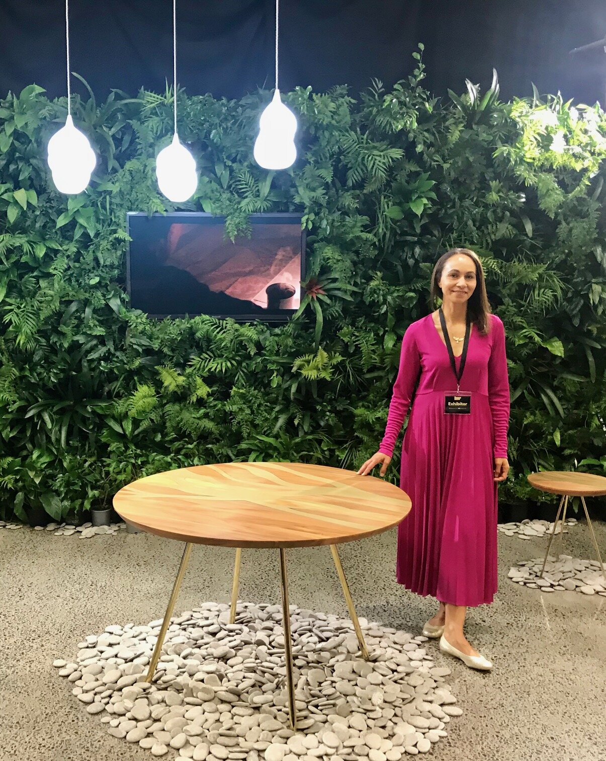 Creative director and founder, Lyzadie Renault, by the FLOW Round Dining Table.