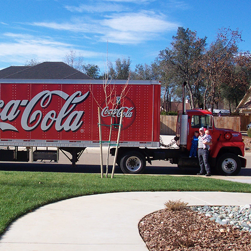 FEBRUARY 2003 - Near the end of my time with Coca-Cola, pictured here with my two sons, Danny and Tommy, when they were just babies. I performed nearly every job there was available at the company, I was always eager to learn new skills. The staff was entrenched at that time though, so my goal of a sales position and eventual regional or marketing management just wasn't in the cards. Self employment was the way for me.