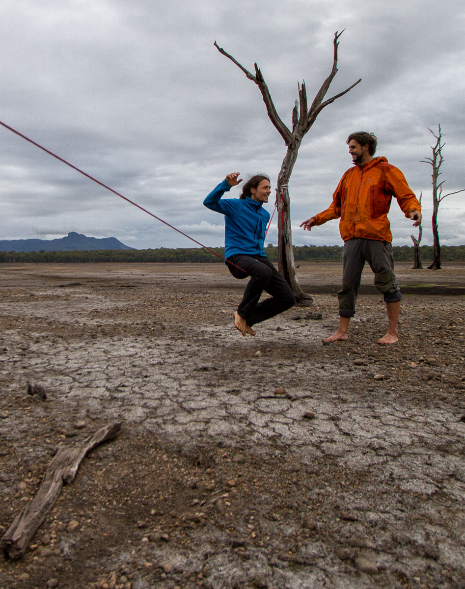 Even photographers can learn how to slackline, Stepan giving Kamil Sustiak a few pointers on a dry lakebed in Tasmania.  Simon Madden
