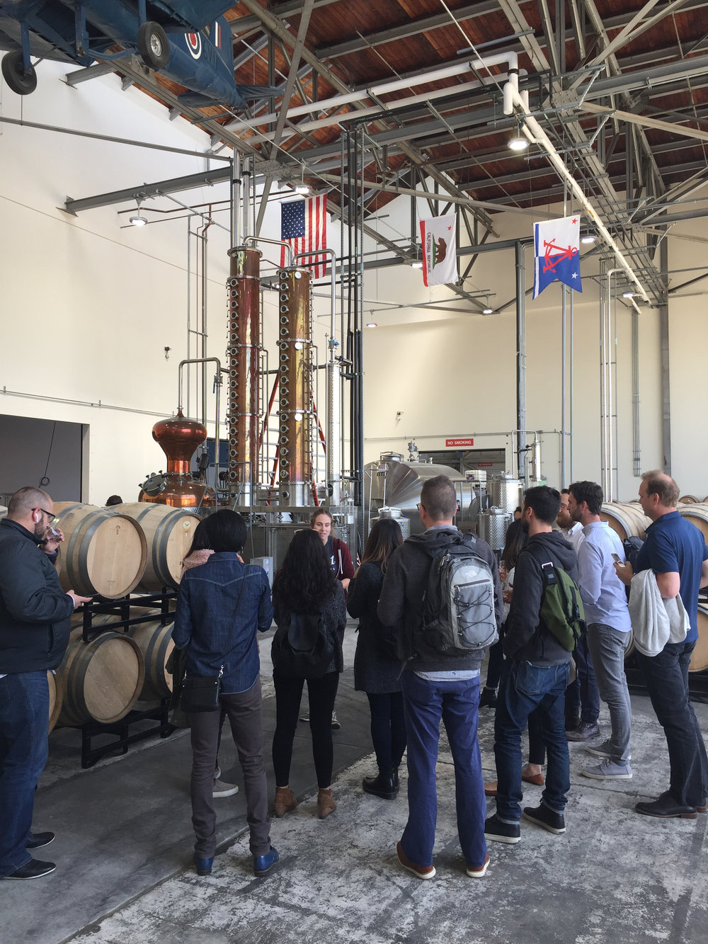 VDT Staff learn about the vodka distilling process at Hangar 1