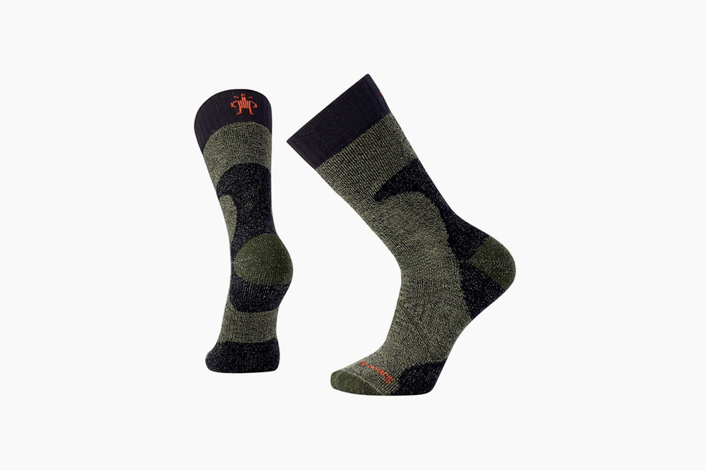 Smartwool Men's PhD® Hunt Socks - Soggy feet and cotton socks can ruin a trip. That's a fact. Woven with a merino wool and nylon blend, the PHD Hunt socks will keep the dogs from barking during those long hunts on the prairie or in the mountains.