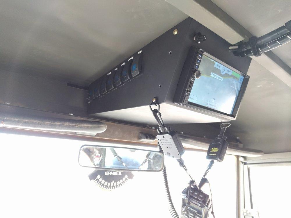 Forward avionics box and display. Houses the radio, CB radio, switches, backup camera selector.