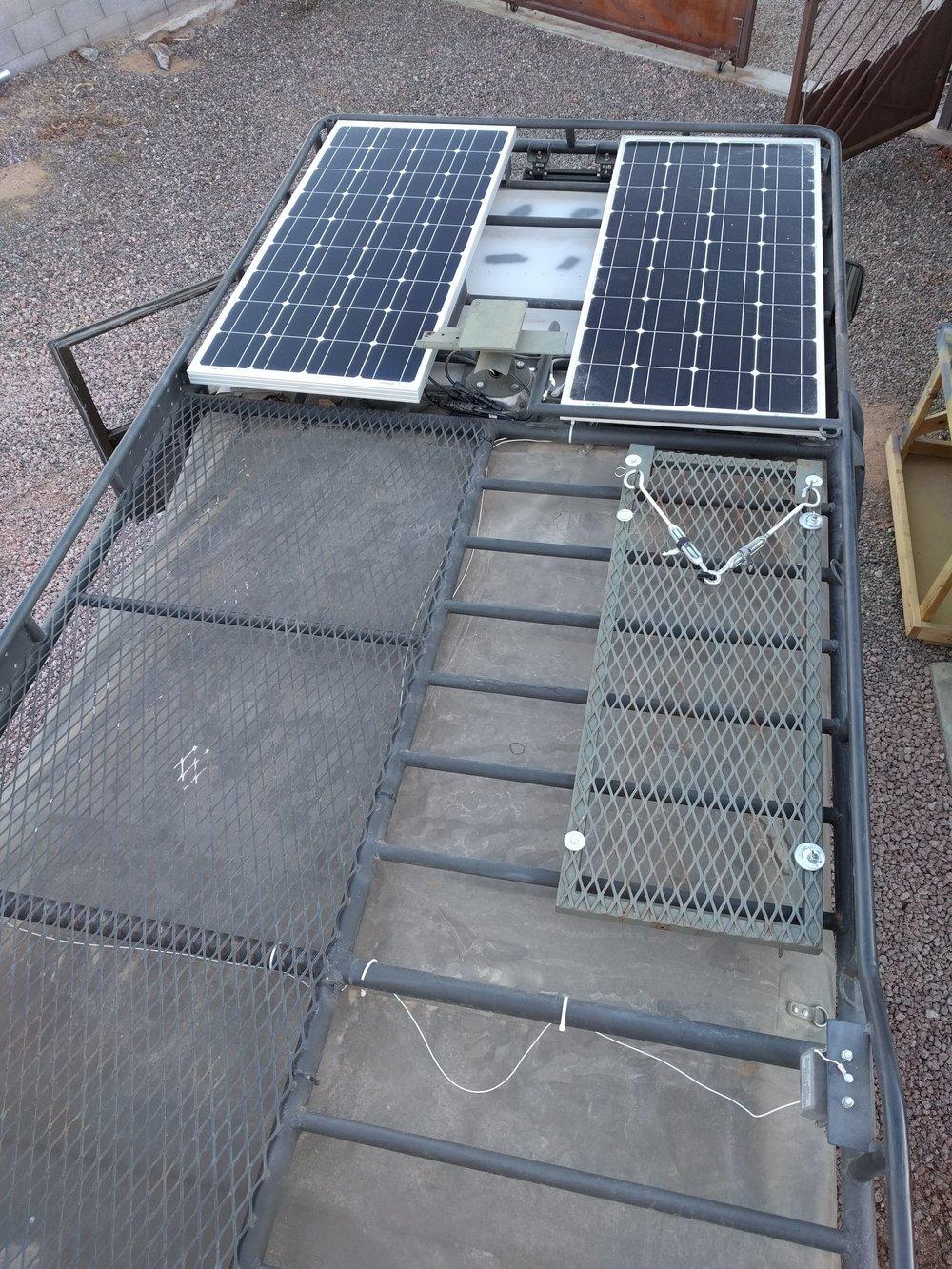 Top of roof rack showing 2-100watt solar panels.