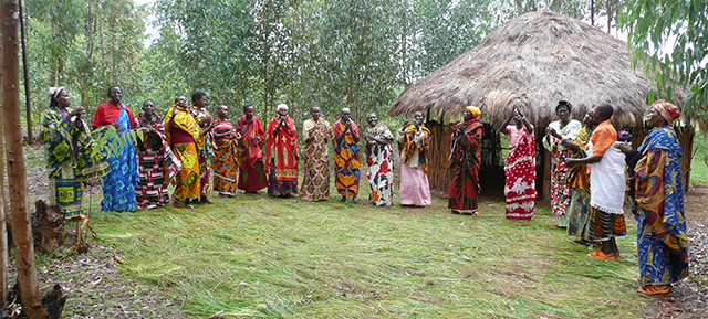 Women gather during a community savings group meeting.