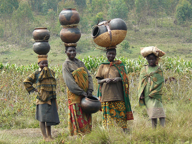 Batwa women selling traditional pots