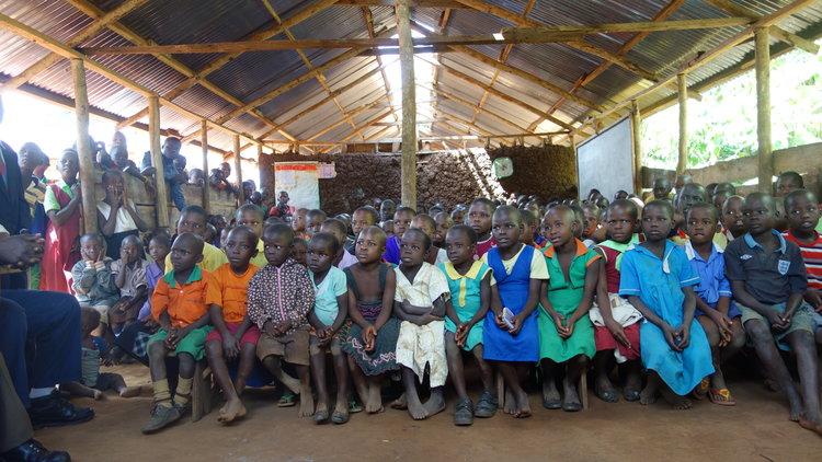 School children in Uganda gather for an assembly.