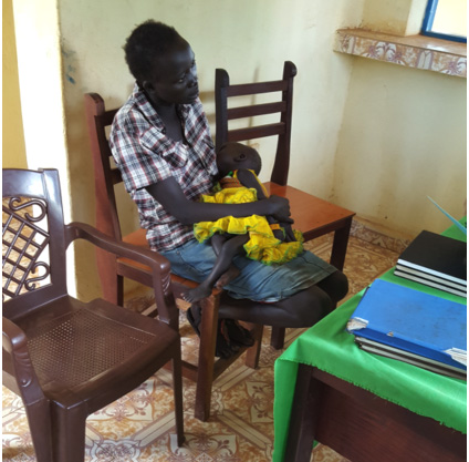 Akuol receives an emergency loan in South Sudan.