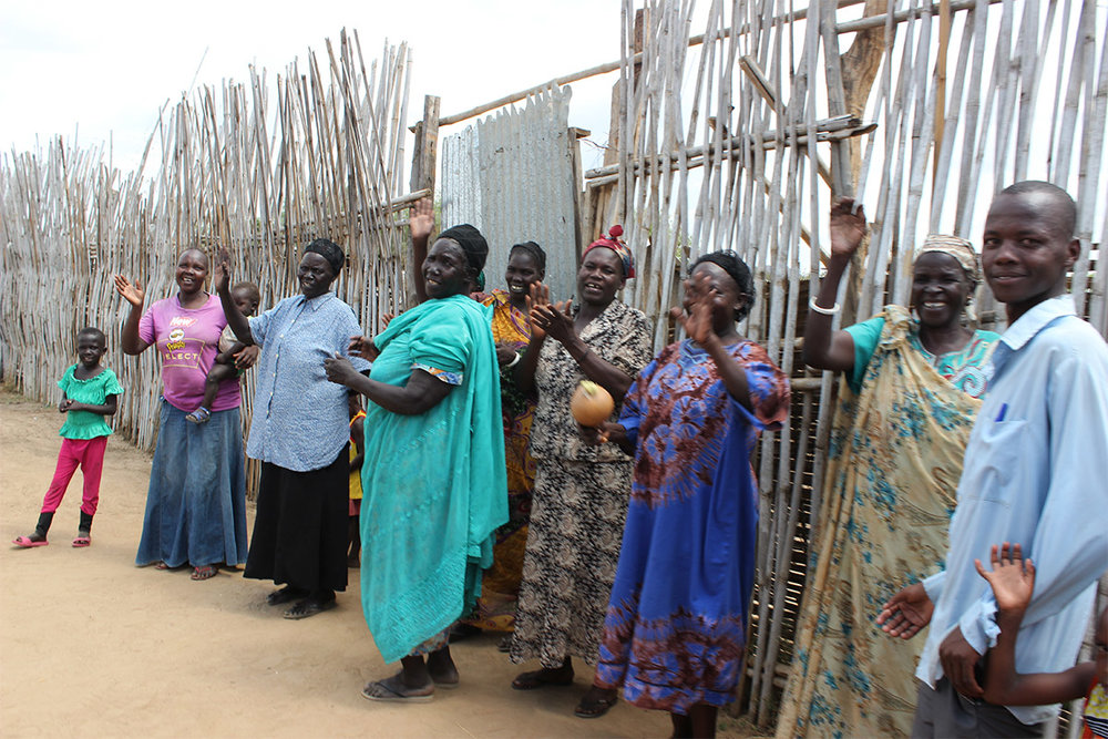 Visitors receive a warm reception inside a displaced persons community in South Sudan.