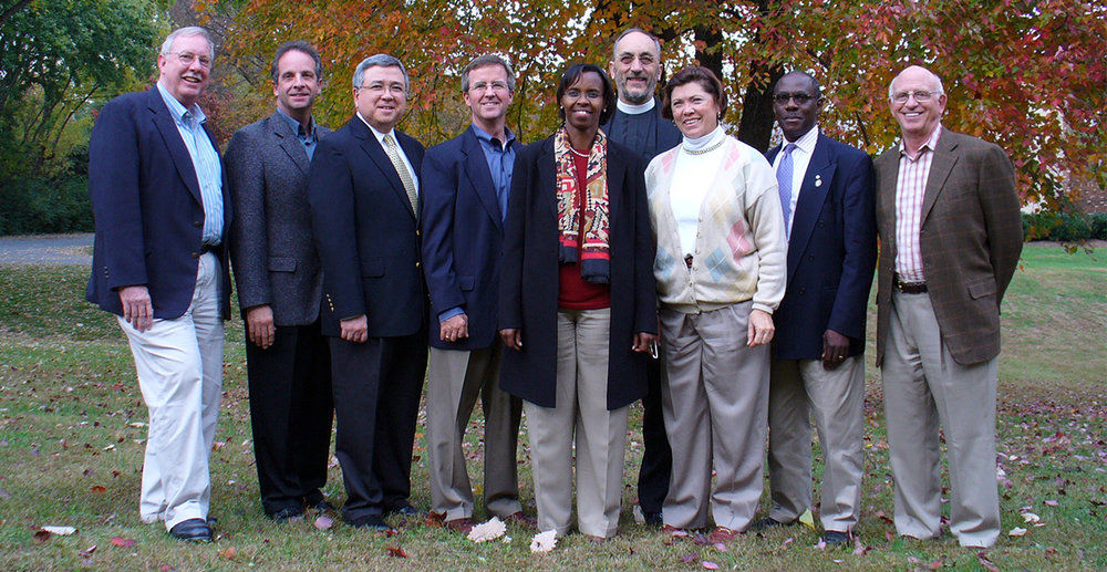 Five Talents International Board of Directors in 2005: Jim Oakes, Joseph Paulini, Keith Chua, Hooks Johnston, Valentine Gitoho, Martyn Minns, April Young, Fred Kalema-Musoke, and Harty Gardner.