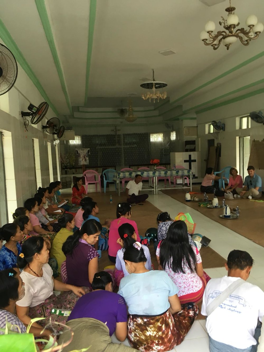 Members of a Five Talents community savings group gather in a local church. Groups like this one are growing in Myanmar through the work of Five Talents and the Mother's Union.
