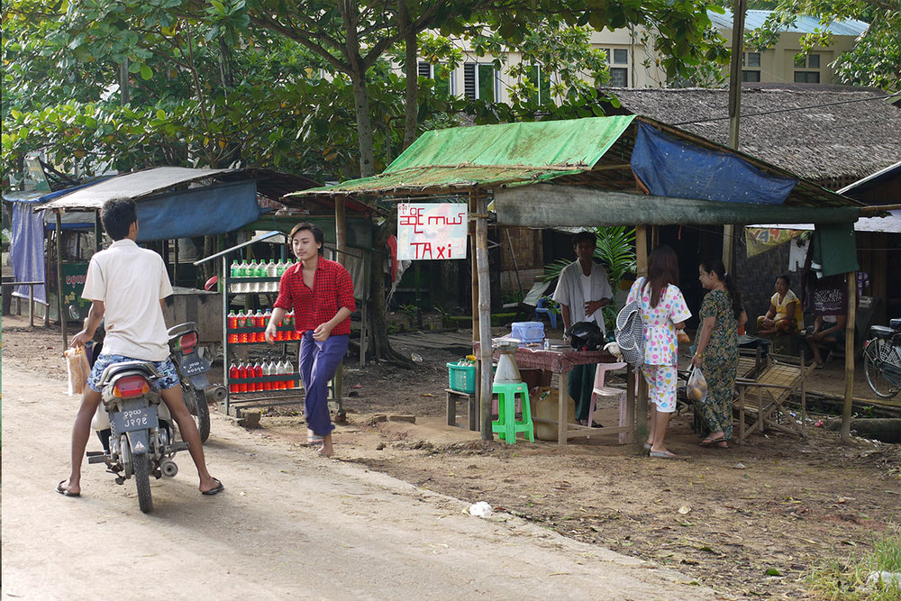 Motorcycle or bicycle taxi are common forms of transportation in Myanmar.