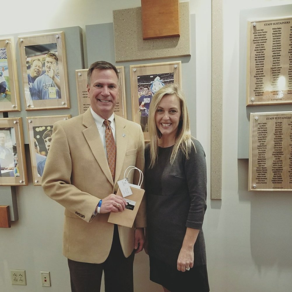 Laura Latham, CEO of Flashlight presenting Ken File, President of Damar Foundation, Indianapolis with a check from one of our partners.