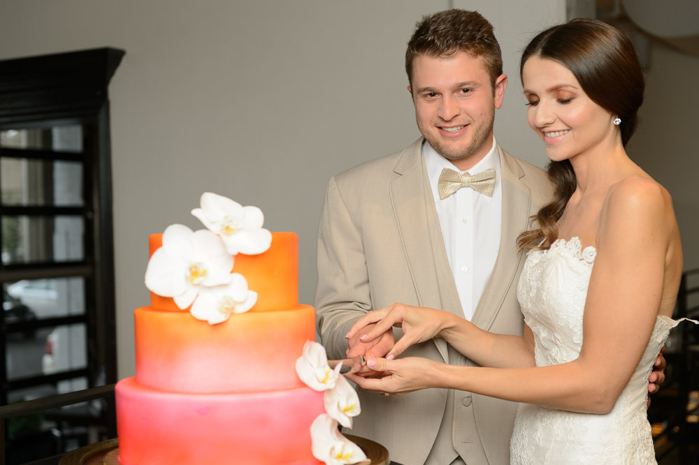 Couple cutting wedding cake