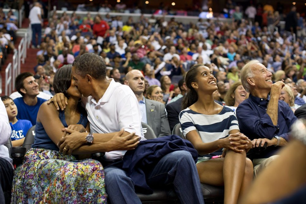 Obamas at basketball game