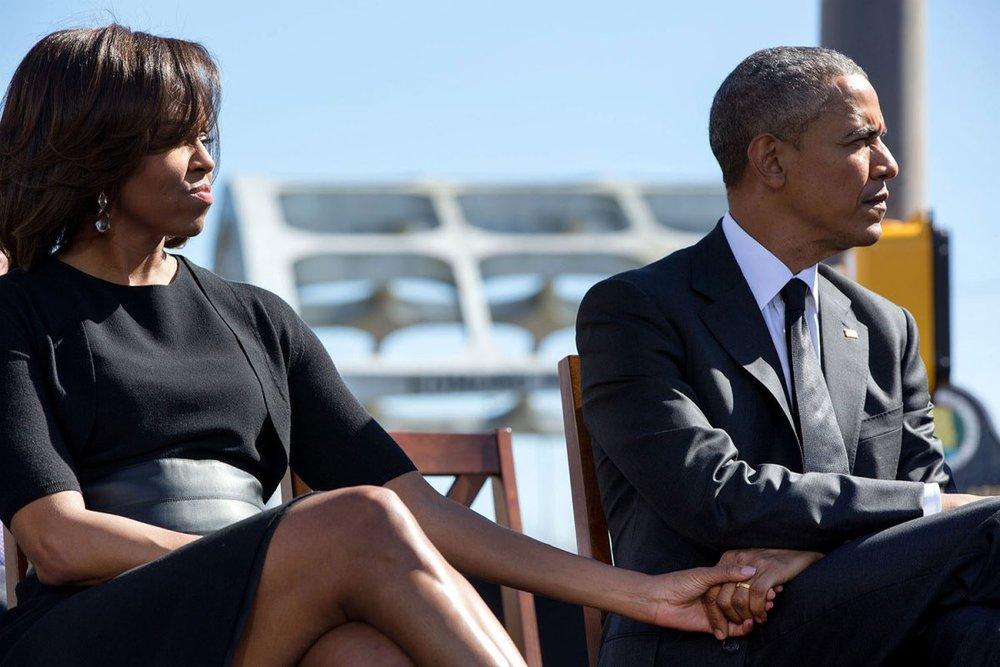 Obamas holding hands