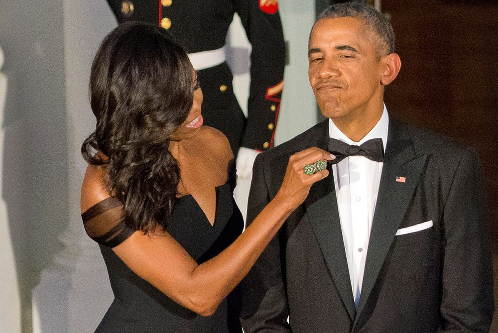 Michelle Obama fixing Barack Obama's tie