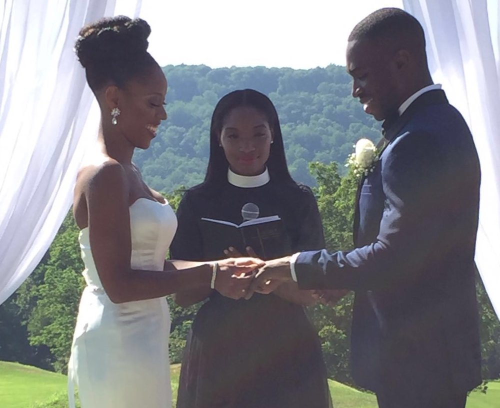Couple-being-married-Rev-Roxy-Andrew-Roby-events
