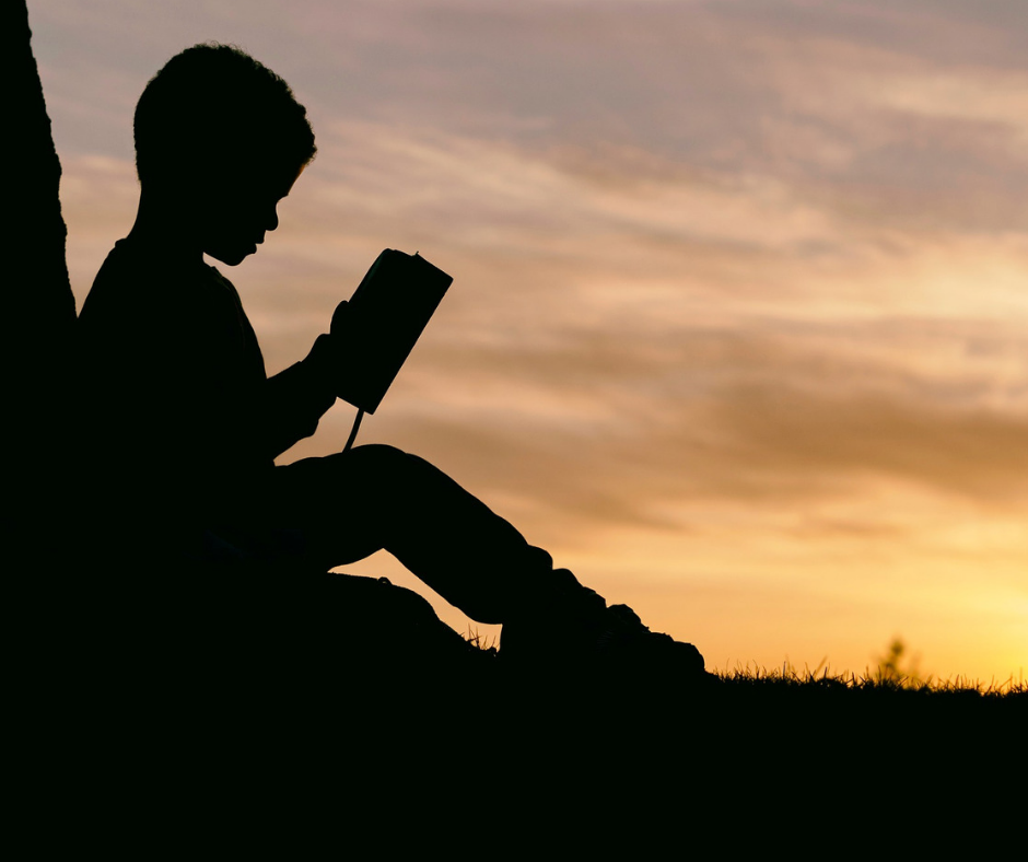FB- Boy reading Sunset.png