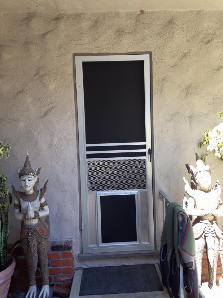 swinging-door-with-pet-door.jpg