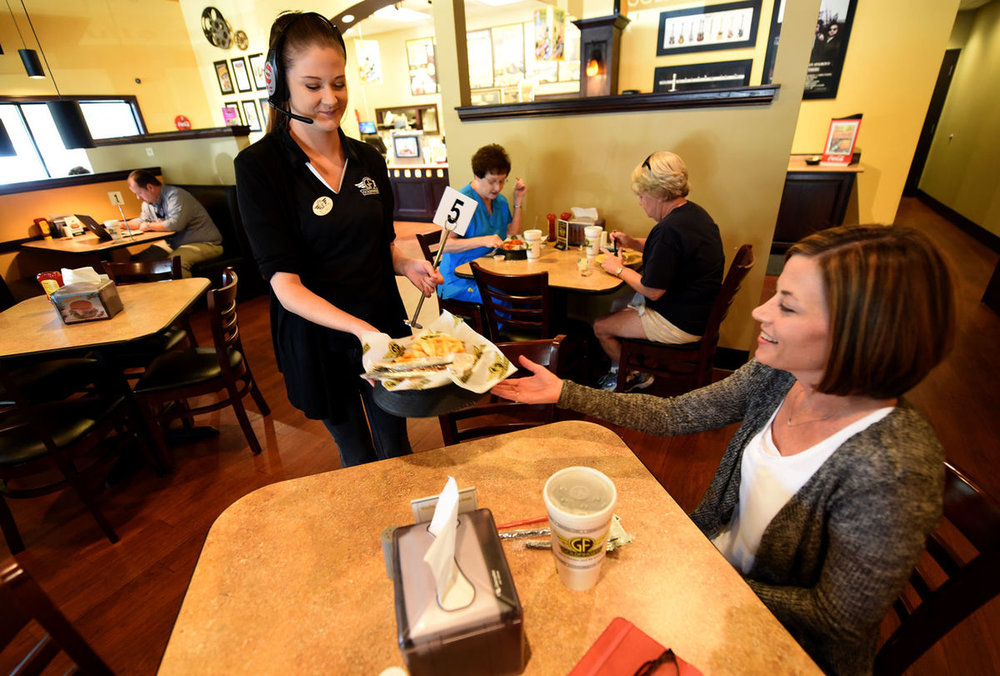 Danny Tindell/ Dothan Eagle / Kyla Grantham with Goldfingersdelivers Mandy Eubanks her order at the restaurant in Dothan on Wednesdday.