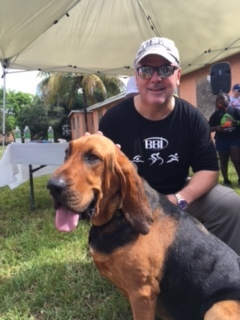 Pictured is BBI's president Robert Taylor Jr. at the event with Mercy The Dog.