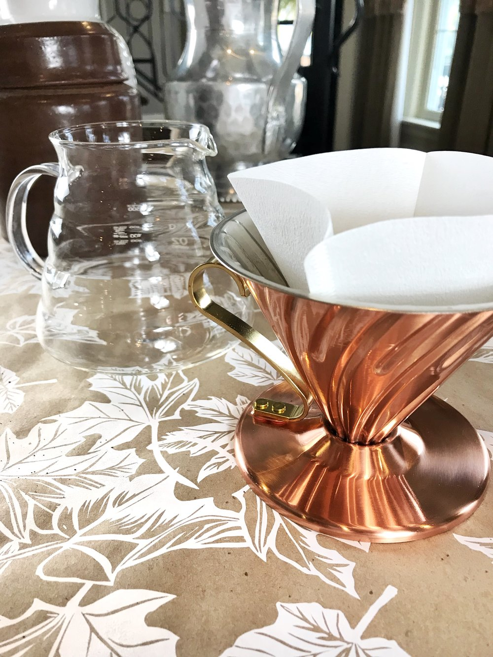 Step 2:Insert a Coffee Filter - Place the filter inside of the copper series dripper.