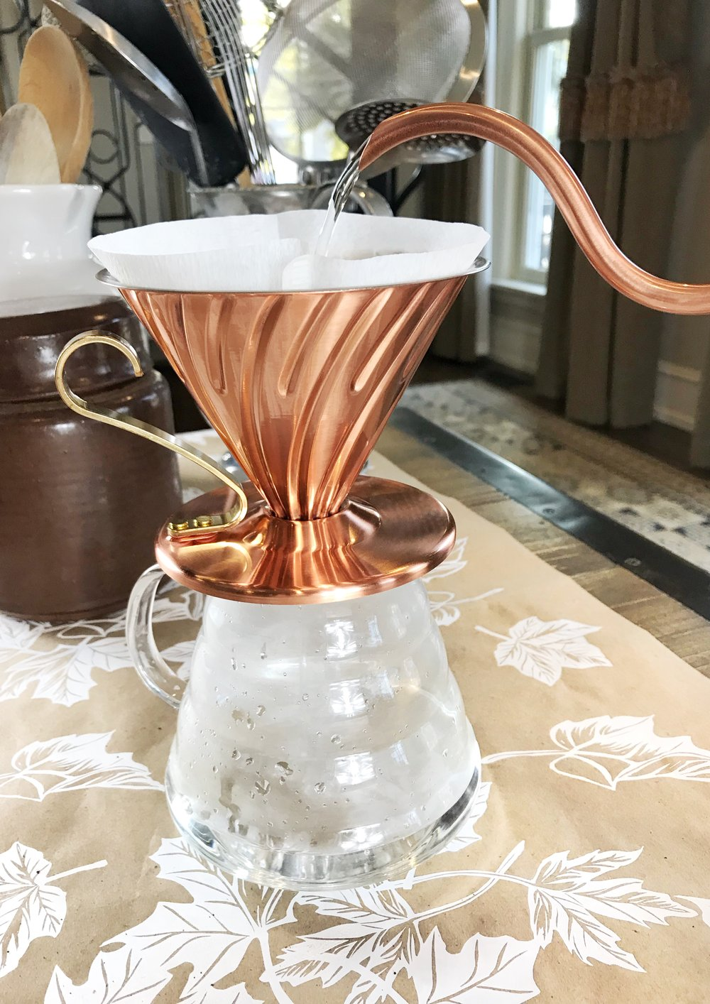 Step 3:Moisten the coffee filter - Put water in you kettle (or just into another glass if you'd like) and dampen the coffee filter. This prevents your pour over coffee from taking on a