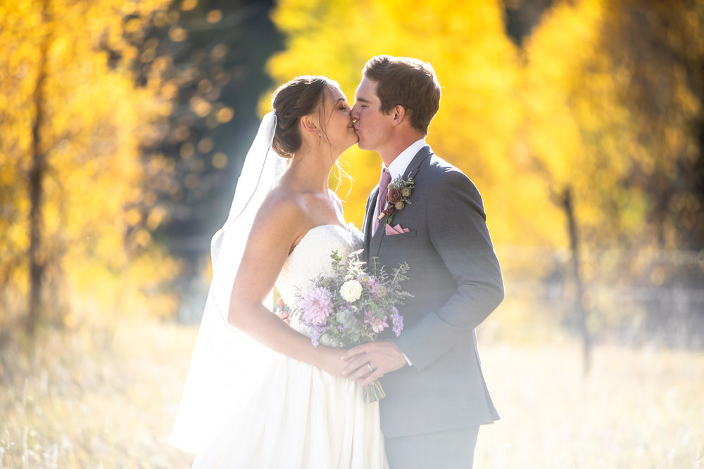 Kissing in an aspen field during a wedding near Durango, Colorado