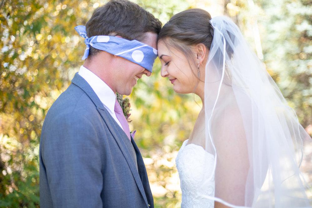 blind fold praying before wedding first look