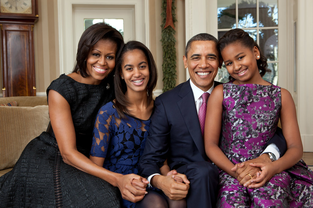 President Barack Obama, First Lady Michelle Obama, and their daughters, Sasha and Malia, sit for a family portrait in the Oval Office, Dec. 11, 2011. (Official White House Photo by Pete Souza)