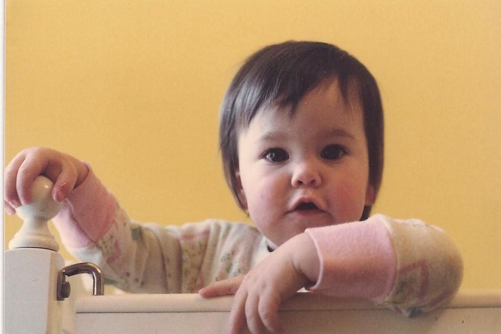 Rebecca taking her turn in the crib (December 1977)