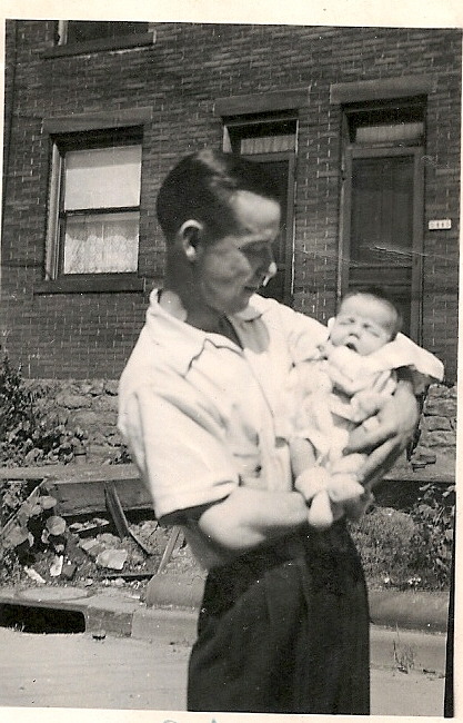 My dad holds me in his arms in 1942.