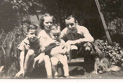 My brother Danny, sister Carol, Dad and our dog Pal in backyard of 5413 Sunnyside Street. That's yours truly in the front.