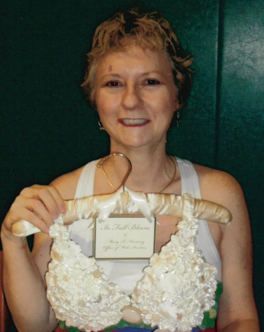 This is me in 2009 - my hair was growing back; a dear friend purchased this custom decorated bra for me at a breast cancer awareness auction in Buffalo, New York.