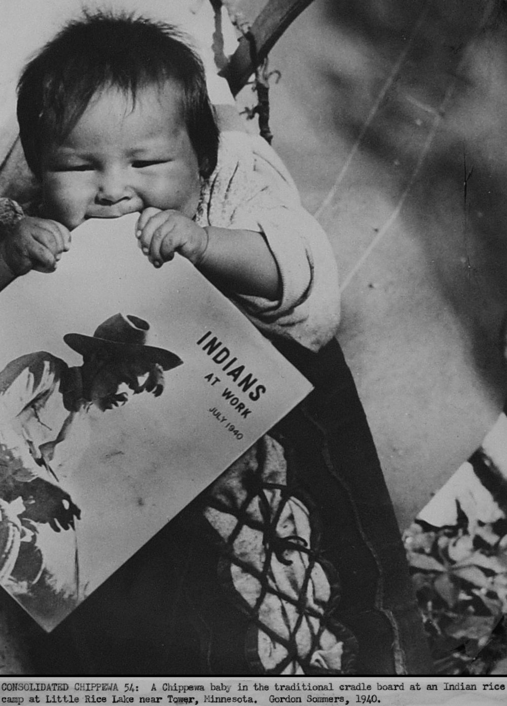 113 1940_govt_photo_minnesota_farming_scene_chippewa_baby_teething_on_magazine_indians_at_work.jpg
