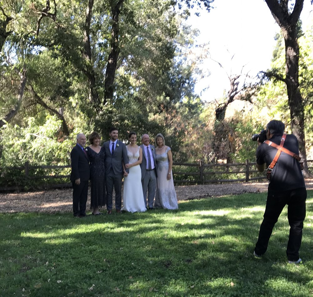 Leigh Creekside Park is a favorite venue for weddings and wedding photos. Bride and groom with parents, September 23, 2017 .