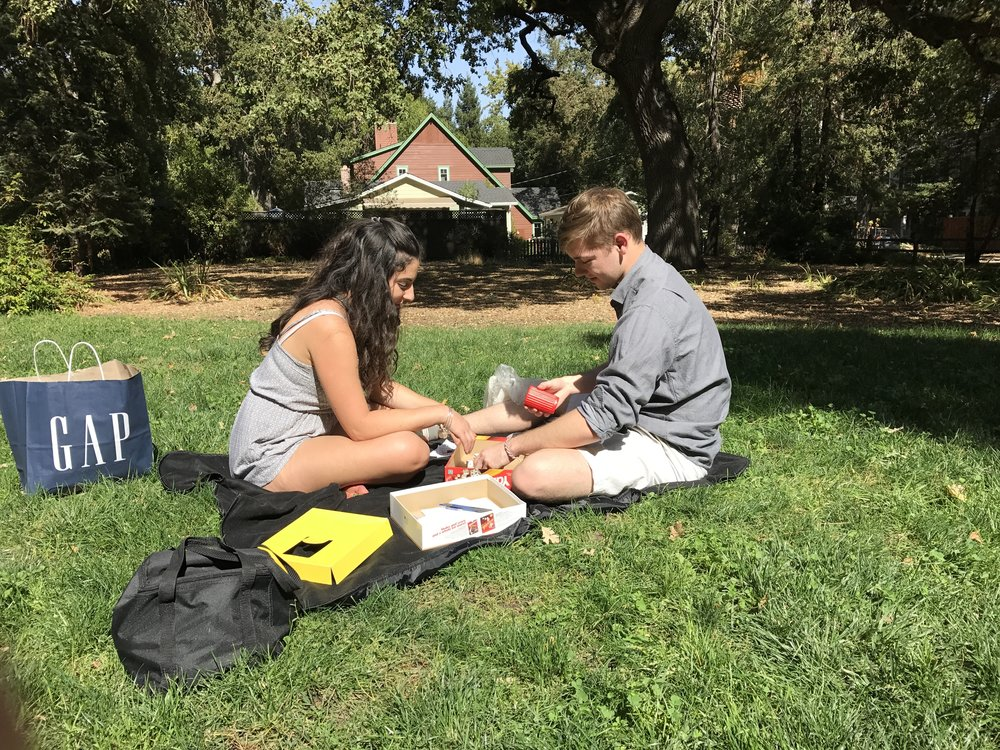 Adina and Ryan - board game in the park.
