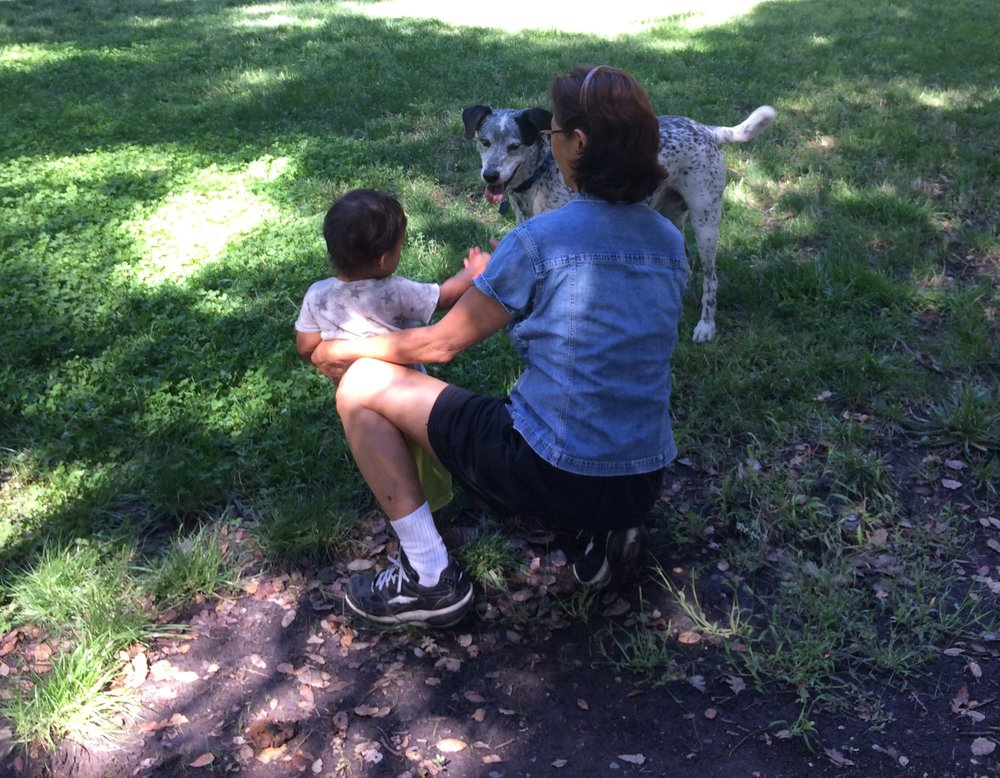 Heni with grandson, and Bodhi the dog.
