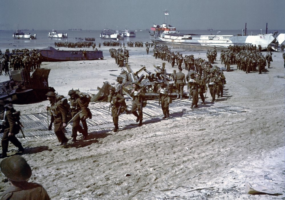 Canadian soldiers, sailors, and airmen shortly after securing the beachhead on the morning of June 6th, 1944. 340 died, and 574 were wounded in this defining historical moment.