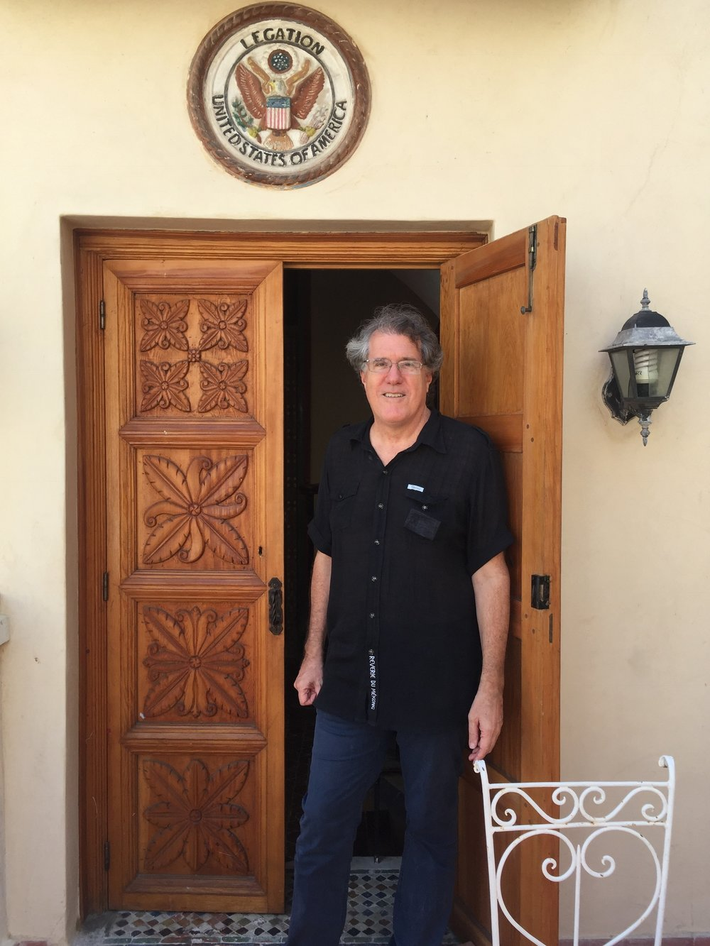 Our gracious host, John Davison, in front of the doors donated by Carol Malt.JPG