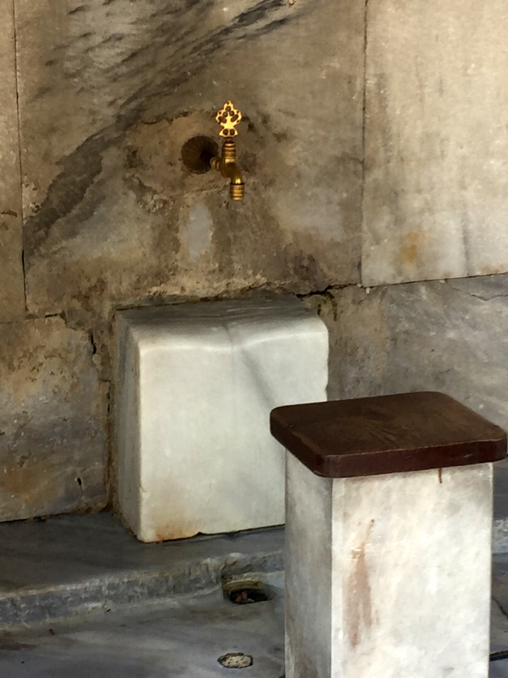 One of the many taps where believers wash their face, hands and feet before prayer.