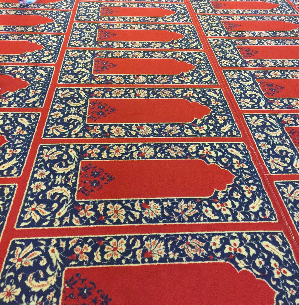 Notice how the carpet is marked so during group prayer, everyone knows where to stand.