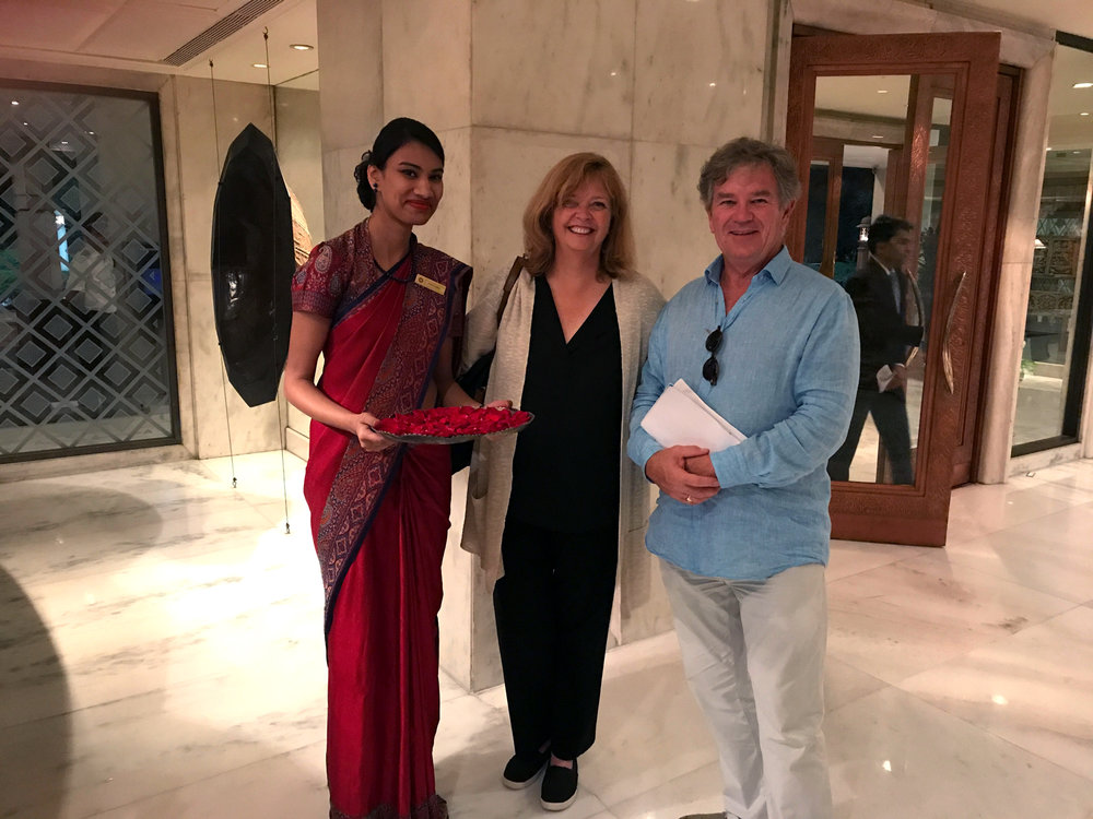 Being welcomed with flowers at the Taj.
