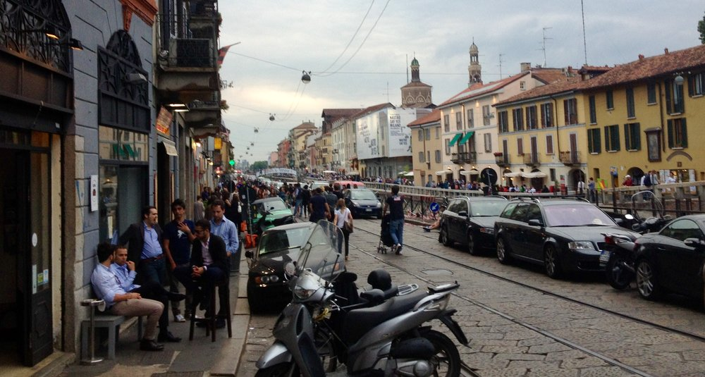 A street in Milan during Aperitivo - the highlight of Tuscan afternoons for many.