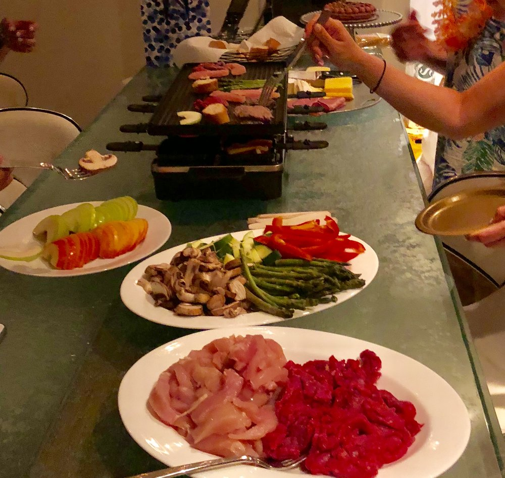 Here is a full dinner we made over the  Raclette grill  top with thinly sliced chicken and filet mignon, mushrooms, zucchini, asparagus, peppers, deli meats, apples, bread, and cheeses. Even our vegetarian friends had more than enough options!